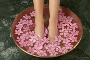 Relaxing foot bath with white orchids